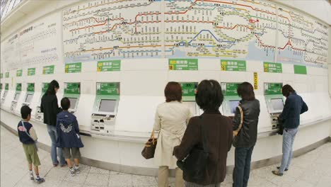 Passengers-purchase-JR-subway-tickets-in-Ueno-Station-Tokyo-Japan
