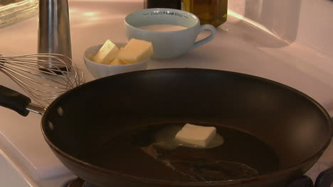 A-cube-of-butter-melts-in-a-skillet