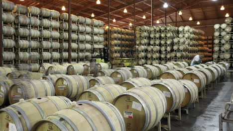 A-cellar-crew-tops-off-wine-barrels-during-harvest-in-California-wine-country