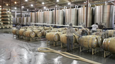 A-cellar-crew-tops-off-wine-barrels-during-harvest-in-California-wine-country-1
