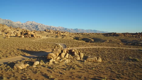 An-aerial-shot-over-the-Alabama-Hills-outside-Lone-Pine-California-with-Mt-Whitney-and-Sierras-background-3