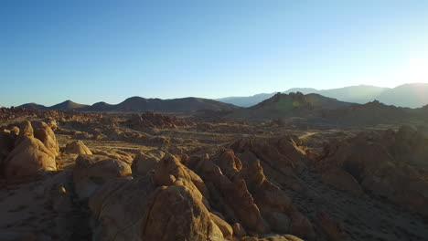 An-aerial-sunset-shot-over-the-Alabama-Hills-outside-Lone-Pine-California-with-Mt-Whitney-and-Sierras-background-3