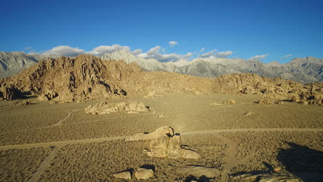 A-high-aerial-sunset-shot-over-the-Alabama-Hills-outside-Lone-Pine-California-with-Mt-Whitney-and-Sierras-background-2