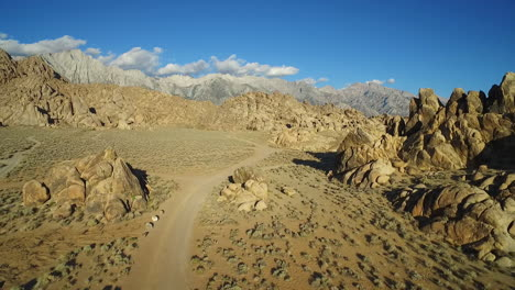 A-high-aerial-sunset-shot-over-the-Alabama-Hills-outside-Lone-Pine-California-with-Mt-Whitney-and-Sierras-background-6
