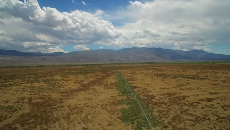 An-aerial-over-the-dry-owens-valley-region-of-California-with-irrigation-lines-foreground