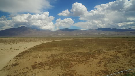 An-aerial-over-the-dry-owens-valley-region-of-California-with-irrigation-lines-foreground-2