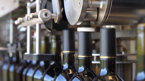 Close-up-shots-of-automation-along-the-assembly-line-inside-a-wine-bottling-factory
