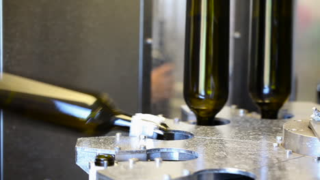 Close-up-shots-of-automation-along-the-assembly-line-inside-a-wine-bottling-factory-2