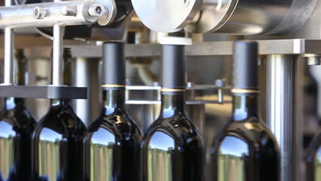 Close-up-shots-of-automation-along-the-assembly-line-inside-a-wine-bottling-factory-7