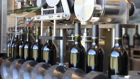 Close-up-shots-of-automation-along-the-assembly-line-inside-a-wine-bottling-factory-8