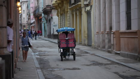 A-pedicab-heads-down-the-streets-of-Old-Havana-Cuba
