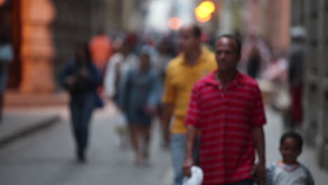 People-come-into-focus-as-they-crowd-the-streets-of-Old-Havana-Cuba