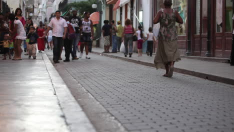 People-walk-on-the-cobblestone-strets-of-Havana-Cuba