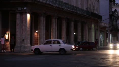 Old-cars-drive-on-the-streets-of-Havana-Cuba-at-night