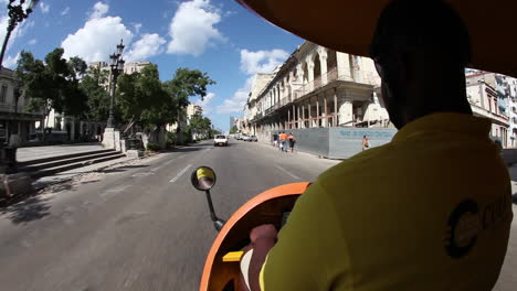 POV-from-a-pedicab-taxi-moving-through-the-old-city-of-Havana-Cuba