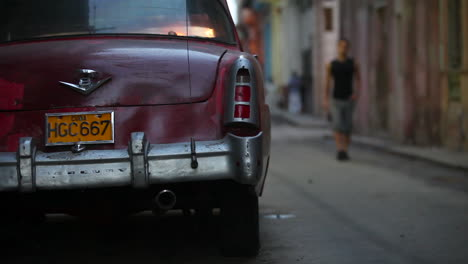 A-narrow-alleyway-in-Havana-Cuba-at-dusk-with-classic-car-foreground