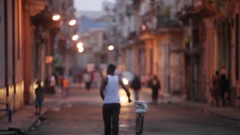 People-walk-on-the-streets-of-Havana-Cuba-at-dusk
