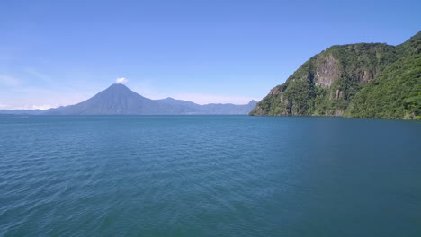 Aerial-over-Lake-Amatitlan-in-Guatemala-reveals-the-Pacaya-Volcano-in-the-distance-3