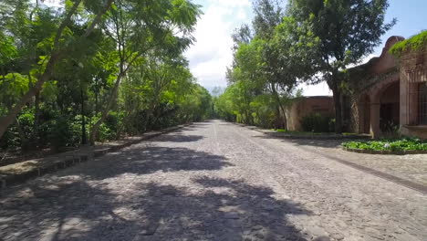 An-aerial-along-a-narrow-small-road-in-South-America-or-Central-America-