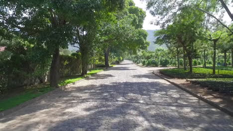 An-aerial-along-a-narrow-small-road-in-South-America-or-Central-America-1