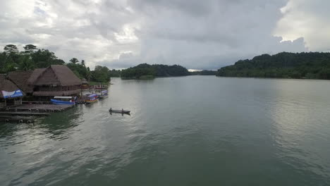 An-aerial-over-a-native-canoe-on-the-Rio-Dulce-River-in-Guatemala-2
