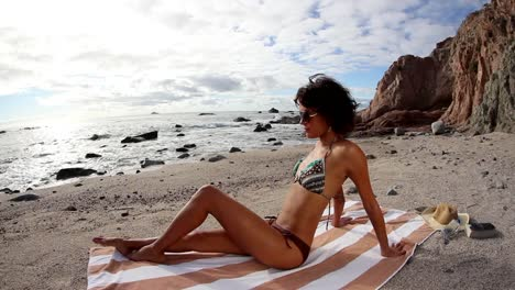 Woman-Relaxing-on-Beach-0-30
