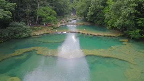 An-aerial-over-remarkable-waterfalls-and-green-polls-on-the-Semuc-Champey-river-in-Guatemala