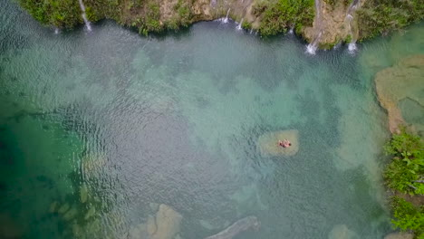 An-aerial-over-remarkable-waterfalls-and-green-polls-on-the-Semuc-Champey-river-in-Guatemala-1