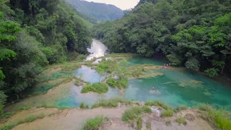 An-aerial-over-remarkable-waterfalls-and-green-polls-on-the-Semuc-Champey-river-in-Guatemala-2