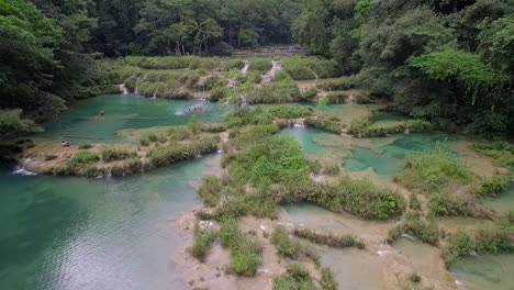 An-aerial-over-remarkable-waterfalls-and-green-polls-on-the-Semuc-Champey-river-in-Guatemala-4