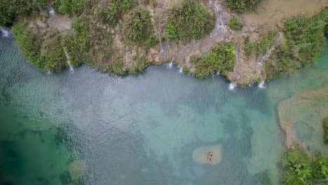An-aerial-over-remarkable-waterfalls-and-green-polls-on-the-Semuc-Champey-river-in-Guatemala-5