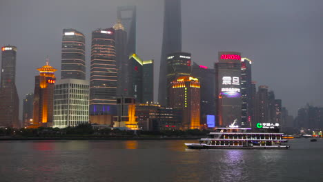 The-night-skyline-of-Shanghai-China-with-river-traffic-foreground-1