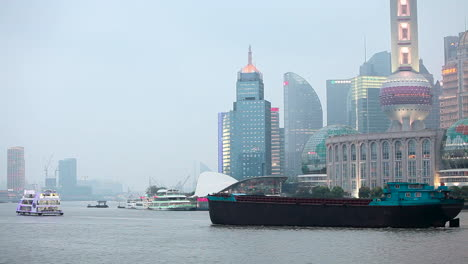 A-barge-travels-on-the-Pearl-River-in-Shanghai-China-in-smog-and-fog-2
