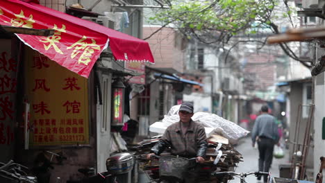 A-small-side-street-with-shops-in-Shanghai-China