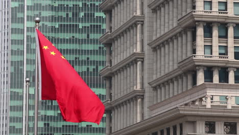 The-Chinese-flag-flies-in-a-business-district-in-Shanghai-China