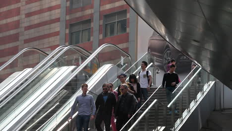 Asian-businesspeople-ride-a-modern-escalator