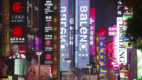 Neon-signs-advertise-products-along-Shanghai-China-main-street-at-night