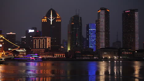 The-night-skyline-of-Shanghai-China-with-river-traffic-foreground-and-illuminated-tall-ship-passing-3