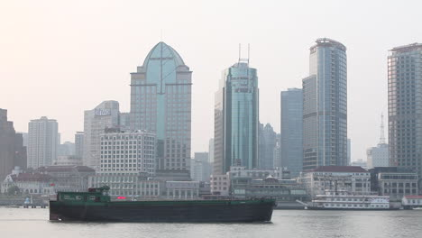 A-barge-travels-on-the-Pearl-River-in-Shanghai-China-on-a-hazy-day