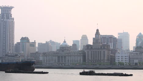 Barges-travel-on-the-Pearl-River-in-Shanghai-China-on-a-hazy-day