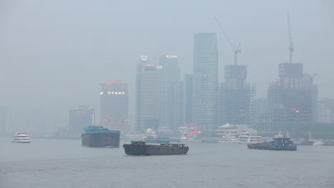 Barges-travel-on-the-Pearl-River-in-Shanghai-China-on-a-hazy-day-2