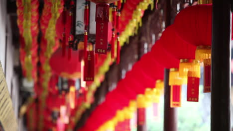 Lanterns-and-tassels-hang-from-the-rafters-in-a-Buddhist-temple-in-China