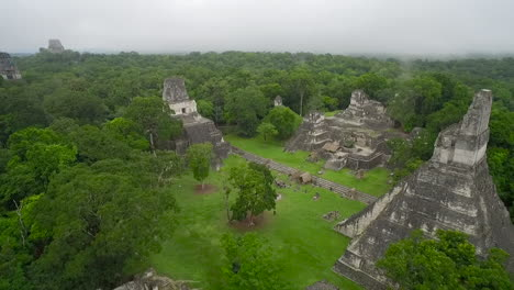 Great-aerial-shot-over-the-Tikal-pyramids-in-Guatemala-3