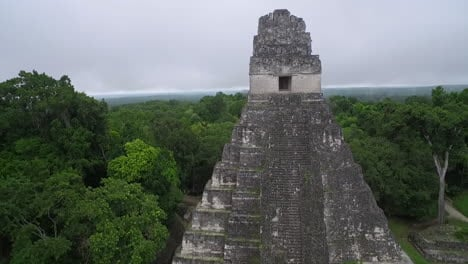 Great-aerial-shot-over-the-Tikal-pyramids-in-Guatemala-4