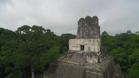 Great-aerial-shot-over-the-Tikal-pyramids-in-Guatemala-5