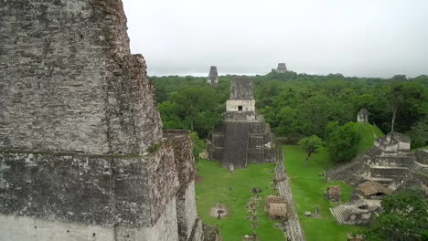 Great-aerial-shot-over-the-Tikal-pyramids-in-Guatemala-6