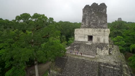 Great-aerial-shot-over-the-Tikal-pyramids-in-Guatemala-8