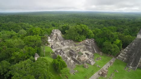 Great-aerial-shot-over-the-Tikal-pyramids-in-Guatemala-9