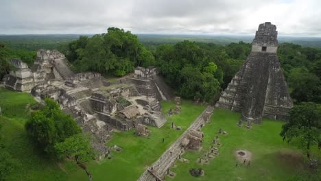 Great-aerial-shot-over-the-Tikal-pyramids-in-Guatemala-10
