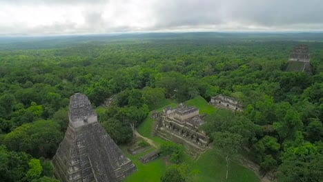 Great-aerial-shot-over-the-Tikal-pyramids-in-Guatemala-11